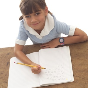 Student Writing in Her Notebook